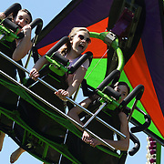 Teenagers and children enjoy the 'Cliff Hanger' ride during the May Fair at Saint Mark's Church, New Canaan, Connecticut, USA. 12th May 2012. Photo Tim Clayton