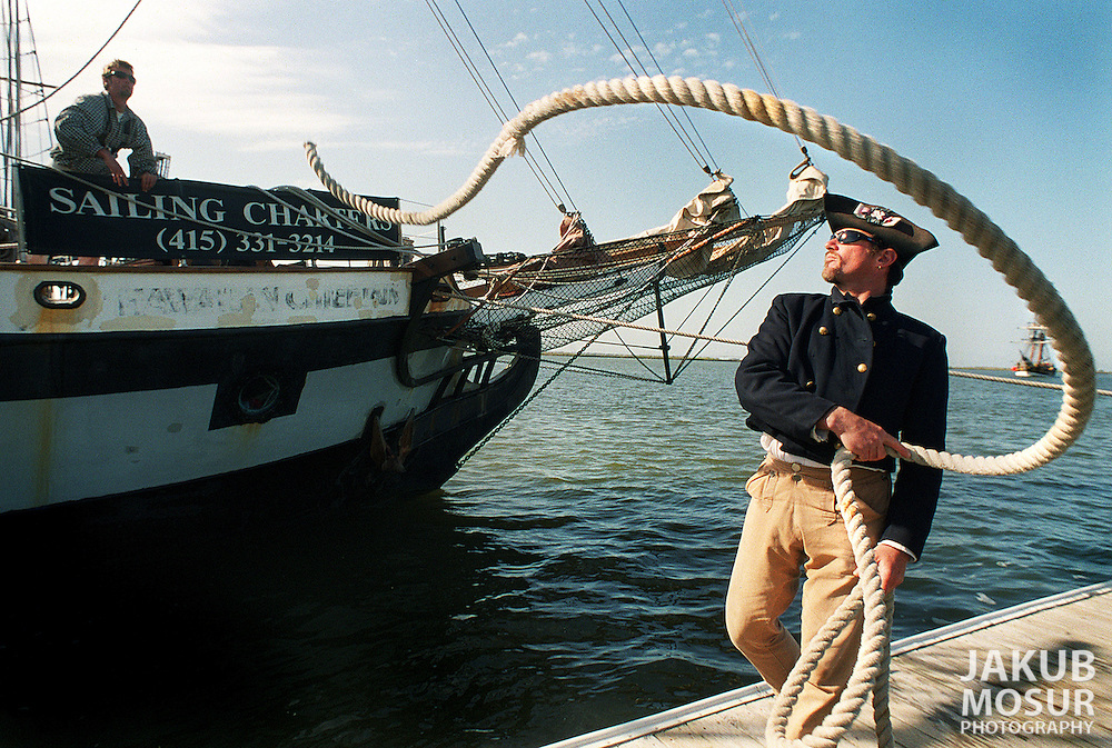 "Captain Ian McIntyre repositions a rope after docking the  Hawaiian Chieftain in Redwood City. McIntyre, of San Rafael, has been the captain of the Hawaiian Chieftain since 1992 and said ""This is a great lifestyle."".Examiner/Jakub Mosur...March 27, 2000."