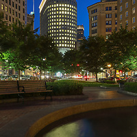 Boston skyline photography from New England photographer Juergen Roth showing the Boston Statler Park and parts of its fountain with the Boston Park Plaza to the right. The left features a rental apartment complex. I noticed the fountain and phot opportunity when I picked up my wife from a gala at the Boston Plaza Hotel. The fountain inspired me to come back at twilight and create this long-exposure photography image of the Boston cityscape. <br />