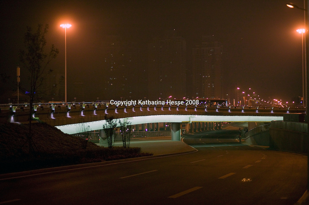 BEIJING, AUGUST 5 :an almost deserted 4th ringroad in seen near the National Stadium during  dress rehearsals for the Olympics .