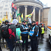 Heavy police present at the Anti-Turkey protest outside the BBC broadcasting house with big banners flags and chanting Turkeys stop killing Kurds in Rojava and anger of UK govt arms sales to Turkeys on 27 January 2019, London, UK.
