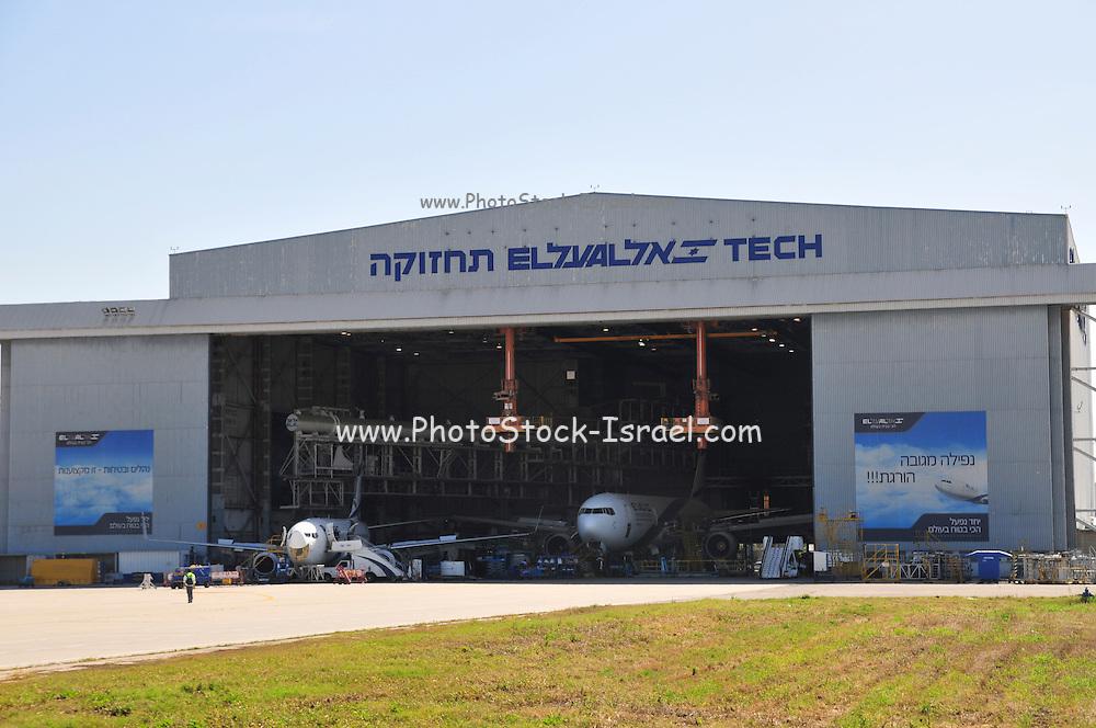Israel, Ben-Gurion international Airport El-Al maintenance working in a maintenance hanger