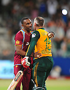 Dwayne Bravo congratulates Morne van Wyk , South Africa  during the 2015 KFC T20 International Series cricket match between South Africa and West Indies at the Kingsmead Stadium in Durban on the 14th of January 2015<br /> <br /> ©Sabelo Mngoma/BackpagePix