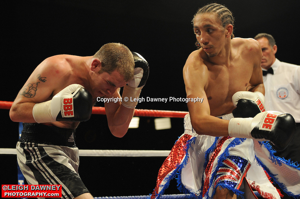 Tyrone Nurse (red,white+blue shorts) defeats Johnny Greaves at Huddersfield Leisure Centre on 28th May 2010. Frank Maloney Promotions. Photo credit: © Leigh Dawney