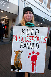 © Licensed to London News Pictures. 01/01/2018. Carmarthen, Carmarthenshire, Wales, UK. Anti-Bloodsport activists gather in the Welsh town of Carmarthen to voice their anger at the continued illegal hunting with dogs - hunting with dogs was made illegal in 2004 by The Hunting Act 2004 (c37). The Anti-Hunt protest takes place on the day that the Carmarthenshire Hunt have chosen to parade through the town to collect money and support for their blood-sports. Photo credit: Graham M. Lawrence/LNP