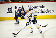 SHOT 2/25/17 10:00:49 PM - The Buffalo Sabres' Kyle Okposo #21 stick handles past the Colorado Avalanche's Mikko Rantanen #96 during their NHL regular season game at the Pepsi Center in Denver, Co. The Avalanche won the game 5-3. (Photo by Marc Piscotty / © 2017)