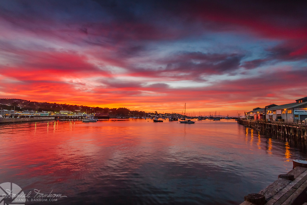 Sunset sky and reflections in the Monterey, California Harbor and Fisherman's Wharf