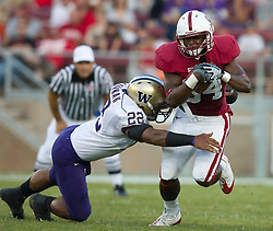 September 26, 2009; Stanford, CA, USA; Stanford Cardinal running back Jeremy Stewart (34) is tackled by Washington Huskies linebacker E.J. Savannah (22) in the first quarter at Stanford Stadium.