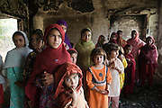 Young school girls look at their burnt and bombed out Government Primary Girls School in Nazarabad, SWAT. ..Most children are looking forward to returning to school but as yet funding for new premises and books, resources etc has not materialised from central government.
