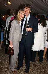 STUART & SUSAN CROSSLEY at the annual Chelsea Flower Show dinner hosted by jewellers Cartier at the Chelsea Pysic Garden, London on 22nd May 2006.<br />