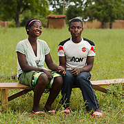 Comfort, approximately 15-17 years old, and her husband, Joshua, approximately 23, near their home in the Upper West region of Ghana on 29 May 2014. Comfort completed school as far as Grade 5, but says she dropped out after her father passed away in 2011 (children in Ghana frequently start school late), and it became difficult for her mother to support the family. After migrating south to the capital, Accra, to work and then returning, she and Joshua met at church and started courting. They married three months ago. According to Joshua, he has had literally a few days of schooling—his father passed away shortly after he started school and he was withdrawn. He farms to support Comfort and himself.