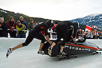 The USA team of Todd Hays, TJ Burns, Alex Sprague and Bill Schuffenhauer compete in the Mens' four-person bobsleigh World Cup competition held at the Whistler Sliding Centre on Feb 7, 2009