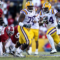 November 6, 2010; Baton Rouge, LA, USA;  LSU Tigers running back Stevan Ridley (34) runs away from Alabama Crimson Tide cornerback Dre Kirkpatrick (21) during the second half at Tiger Stadium. LSU defeated Alabama 24-21.  Mandatory Credit: Derick E. Hingle