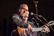 David Broza, an Israeli singer-songwriter, with Peter Yarrow behind him, at the Folk City benefit concert. The concert was held to support a forthcoming exhibit on the folk msusic revival in New York in the 1950s and 60s.