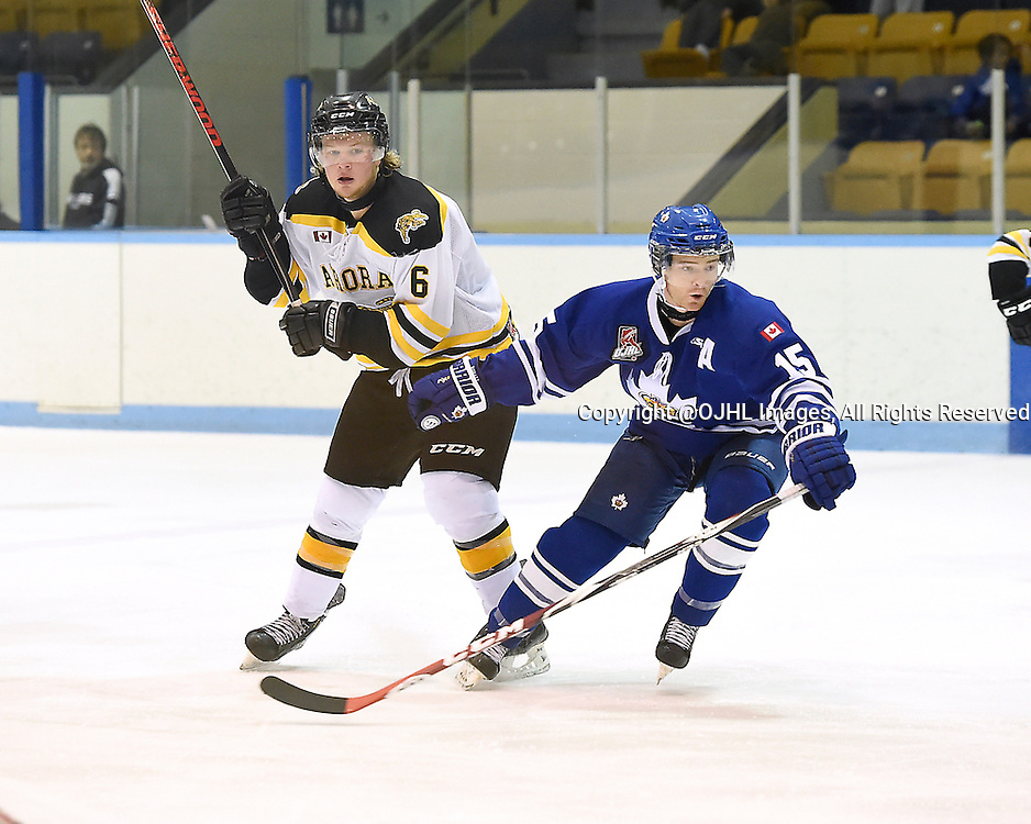 MARKHAM, ON - Oct 11, 2015 : Ontario Junior Hockey League game action between Aurora and Markham, Kyle Locke #6 of the Aurora Tigers and Matthew Dunlop #15 of the Markham Royals pursue the play during the second period.<br /> (Photo by Andy Corneau / OJHL Images)
