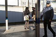 senior people on a railway station platform Japan Tokyo