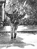 Dancing in the rain on the streets of Woodstock,NY. A portrait of the one & only Jogger John. photo by Star Nigro<br />