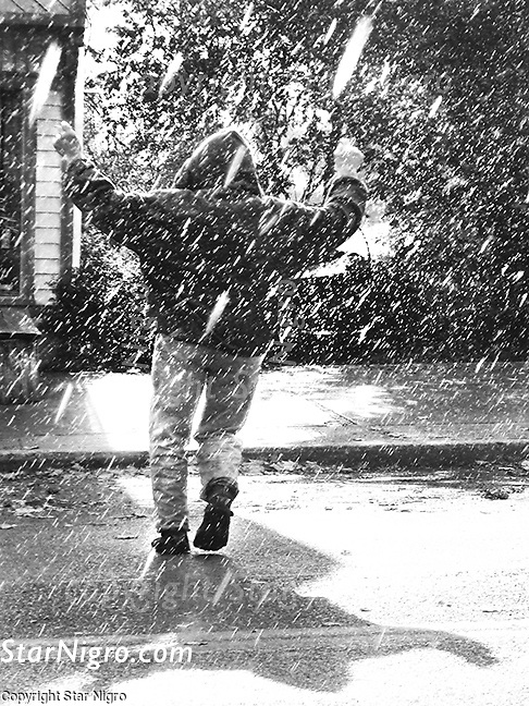 Dancing in the rain on the streets of Woodstock,NY. A portrait of the one & only Jogger John. photo by Star Nigro