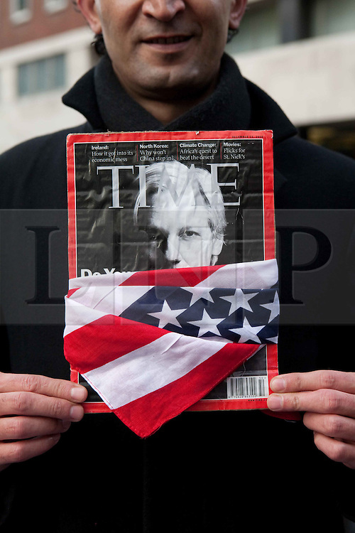 ©London News Pictures. Protesters demonstrate outside the City of Westminster Magistrates Court where Julian Assange is attending an extradition hearing on December 14, 2010 in London, England.Photo credit should read Fuat Akyuz/London News Pictures.