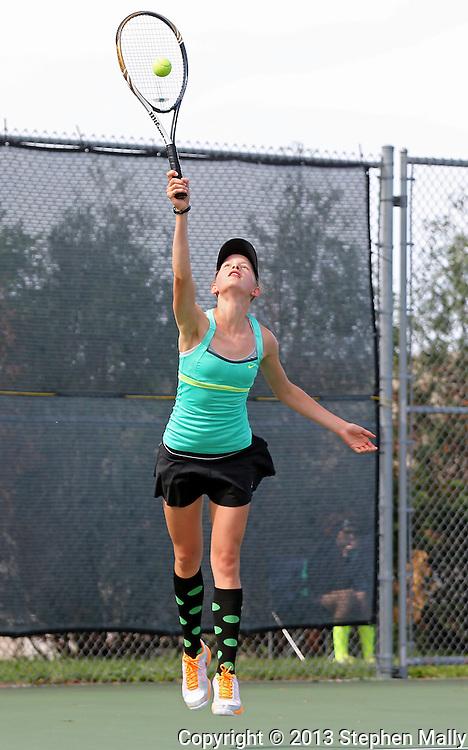 Iowa City West's Maria Burtch serves the ball during the Class 2A state team tennis tournament at Veterans Memorial Tennis Center in Cedar Rapids on Saturday, June 1, 2013.
