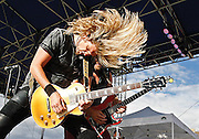 Byron Hetzler/Sky-Hi News.Guitarists Joel Hoekstra, left, and Brad Gillis of Night Ranger perform during the Winter Park Music Festival on Saturday afternoon at Hideaway Park in Winter Park.