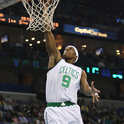 Feb 10, 2010; New Orleans, LA, USA; Boston Celtics guard Rajon Rondo (9) dunks against the New Orleans Hornets during the first quarter at the New Orleans Arena. Mandatory Credit: Derick E. Hingle-US PRESSWIRE