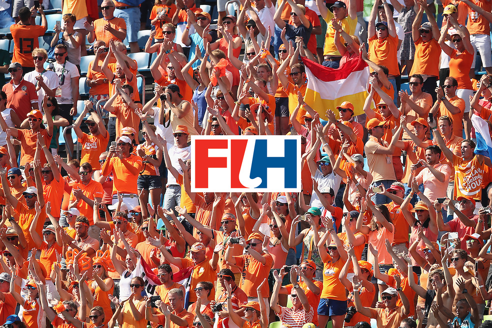 RIO DE JANEIRO, BRAZIL - AUGUST 17:  The Netherlands supporters in the crowd celebrate victory during the womens semifinal match between the Netherlands and Germany on Day 12 of the Rio 2016 Olympic Games at the Olympic Hockey Centre on August 17, 2016 in Rio de Janeiro, Brazil.  (Photo by Mark Kolbe/Getty Images)