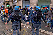 Rome, Italy. 5th January 2016<br /> Police in riot gear away protesters who were demonstrating  against evictions in Rome's Piazza Santi Apostoli.