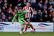 Forest Green Rovers midfielder Charlie Cooper (15) with a shot during the EFL Sky Bet League 2 match between Lincoln City and Forest Green Rovers at Sincil Bank, Lincoln, United Kingdom on 30 December 2017. Photo by Simon Davies.