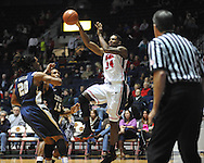 """Ole Miss' Aaron Jones (34) vs. East Tennessee State's Hunter Harris (20) and East Tennessee State's Lester Wilson (15) at the C.M. """"Tad"""" Smith Coliseum in Oxford, Miss. on Saturday, December 14, 2012. Mississippi won 77-55 to improve to 7-1. (AP Photo/Oxford Eagle, Bruce Newman).."""