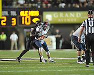 Mississippi quarterback Bo Wallace (14) is sacked by Vanderbilt's Stephen Weatherly (45) in Nashville, Tenn. on Thursday, August 29, 2013.