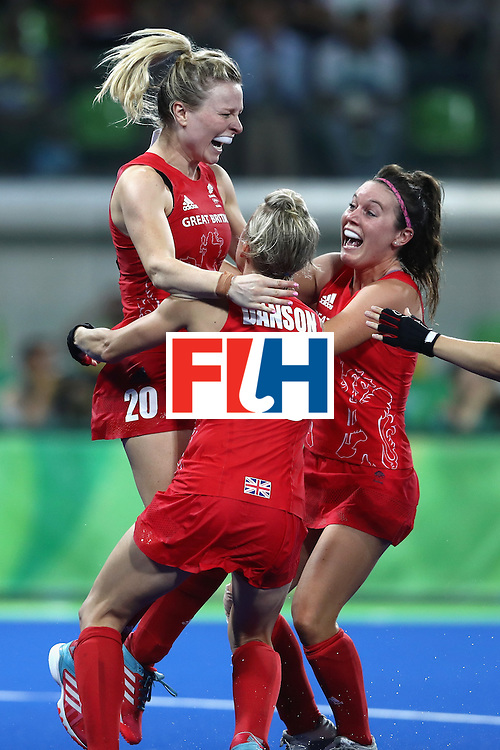 RIO DE JANEIRO, BRAZIL - AUGUST 19:  Great Britain players (Hollie Webb (l)) celebrate winning against Netherlands to win the Women's Gold Medal Match on Day 14 of the Rio 2016 Olympic Games at the Olympic Hockey Centre on August 19, 2016 in Rio de Janeiro, Brazil.  (Photo by David Rogers/Getty Images)