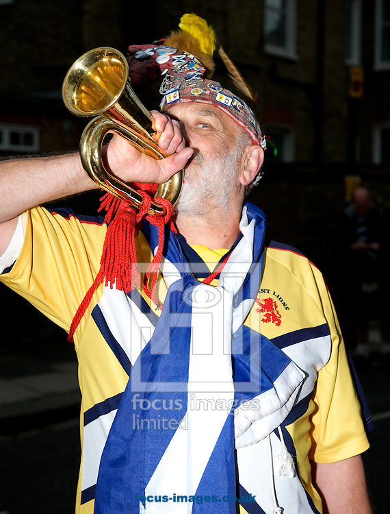 A fan of Scotland with his bugle before the International Friendly match at Craven Cottage, London<br /> Picture by Alan Stanford/Focus Images Ltd +44 7915 056117<br /> 28/05/2014