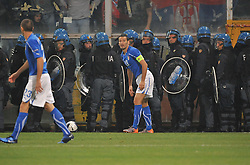 Riot police surround the Serbian fans during the UEFA EURO 2010 Group C qualifying match between Italy and Serbia was suspended at Luigi Ferraris Stadium on October 12, 2010 in Genoa, Italy.