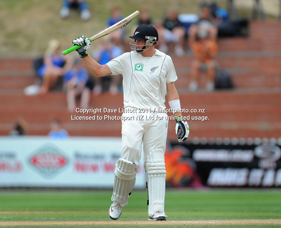 NZ batsman Martin Guptill celebrates his 50 runs. 2nd cricket test match - New Zealand Black Caps v Pakistan, day four at the Basin Reserve, Wellington, New Zealand on Tuesday, 18 January 2011. Photo: Dave Lintott / photosport.co.nz