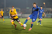 AFC Wimbledon striker Joe Pigott (39) dribbling past Southend United midfielder Sam Mantom (18) during the EFL Sky Bet League 1 match between AFC Wimbledon and Southend United at the Cherry Red Records Stadium, Kingston, England on 1 January 2020.
