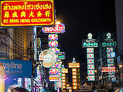 11 SEPTEMBER 2013 - BANGKOK, THAILAND: Neon signs over Yaowarat Road in the Chinatown section of Bangkok. Thailand in general, and Bangkok in particular, has a vibrant tradition of street food and eating on the run. In recent years, Bangkok's street food has become something of an international landmark and is being written about in glossy travel magazines and in the pages of the New York Times.        PHOTO BY JACK KURTZ