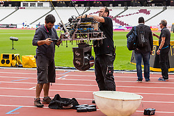 London, 03 August 2017. Technicians adjust an aerial camera ahead of the IAAF World Championships London 2017 at the London Stadium.