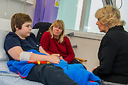 Her Royal Highness meets Charley Saunders, 18 from Poplar, and Danny Roberts, 13 from Maida Vale (pictured), on the ward. The Duchess of Cornwall, Patron, Arthritis Research UK, visits and meets patients of the Adolescent Inpatient Unit at University College London Hospitals.  •	Her Royal Highness then tours a laboratory at the Arthritis Research UK Centre for Adolescent Rheumatology and meeting researchers and supporters. London 12 Feb 2015.