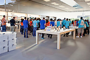 12 JUNE 2009 -- SCOTTSDALE, AZ: Employees gather in the new Apple Store in Scottsdale, AZ, before the store's grand opening Friday. The outlet will be Arizona's largest Apple Store, occupying nearly 10,000 square feet in the Outdoor Lifestyle Center in the Scottsdale Quarter. The store, the fifth in the Phoenix area, uses a radically different design from other Apple Stores in some respects. Ceilings in the building are approximately 20 feet high, and lined with a 75-foot long skylight, reducing dependence on artificial lighting. Aiding the skylight is an all-glass front and rear, permitting visitors to see directly through the store. More than one thousand people lined to get into the store during the grand opening. Photo by Jack Kurtz