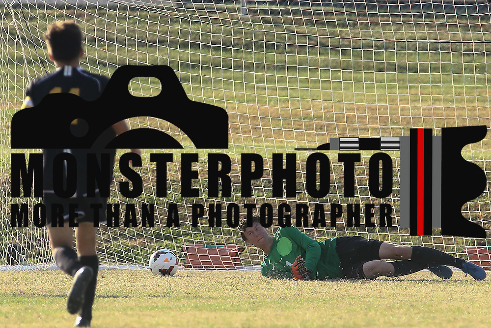 Newark FC Goalkeeper Clayton Hansen (1) attempts to make a driving save in the first half of a regular season soccer match between Newark and Delcastle Thursday, Oct. 22, 2015 at Delcastle in Wilmington.