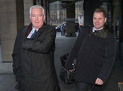 © Licensed to London News Pictures. 19/12/2016. London, UK.    Sir Craig Reedie (L), President, World Anti-Doping Agency, and Olivier Niggli, Director General, World Anti-Doping Agency arrive at Parliament to appear before the Culture, Media and Sport Select Committee taking evidence on combatting doping in sport. Photo credit: Peter Macdiarmid/LNP