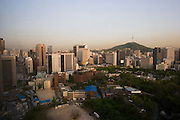 Panoramic sunset view of Downtown Seoul, Namsan Tower and Deoksugung Palace.