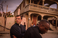 The Rev. Ross Johnson, director of LCMS Disaster Response, walks and talks with the Rev. Eliona Bernard, president of The Evangelical Lutheran Church in Haiti, on Tuesday, Oct. 11, 2016, in Les Cayes, Haiti. LCMS Communications/Erik M. Lunsford