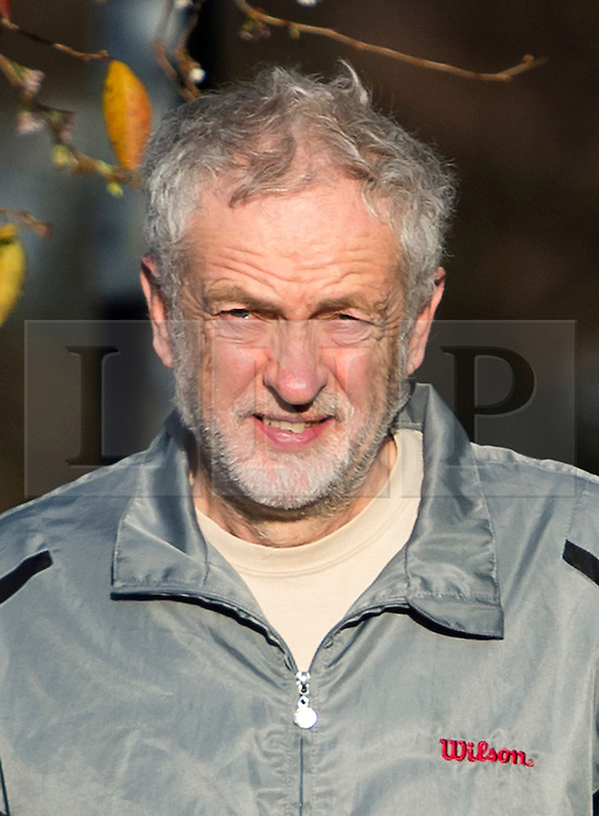 © Licensed to London News Pictures. 28/11/2015. London, UK. Labour Party leader JEREMY CORBYN  carrying coffee and newspapers while returning to his home in Islington, north London this morning (Sat). Jeremy Corbyn has come under pressure from his own party over a potential vote on UK military involvement in Syria. Photo credit: Ben Cawthra/LNP