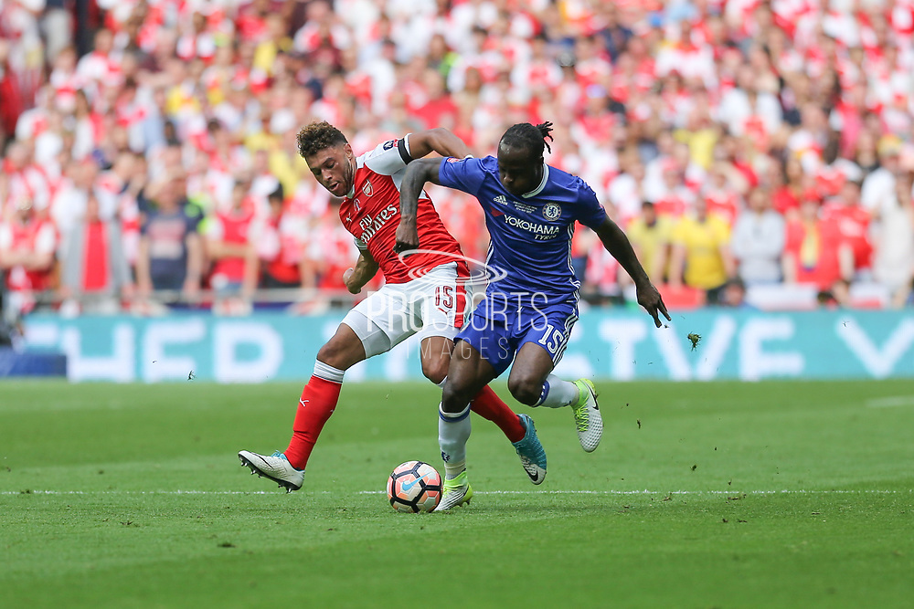 Arsenal's Alex Oxlade-Chamberlain(15) and Chelsea's Victor Moses(15) challenge for the ball during the The FA Cup final match between Arsenal and Chelsea at Wembley Stadium, London, England on 27 May 2017. Photo by Shane Healey.
