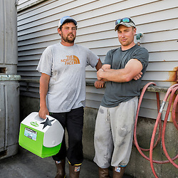 Captain Shaun McLennon (left) and sternman Ryan Feener  of the lobster boat 'Horizon' at the Spruce Head Fisherman's Co-op in South Thomaston, Maine.
