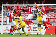 Ebbsfleet united attacker Danny Kedwell (9) battles for possession with AFC Wimbledon goalkeeper George Long (1) during the Pre-Season Friendly match between Ebbsfleet and AFC Wimbledon at Stonebridge Road, Ebsfleet, United Kingdom on 29 July 2017. Photo by Matthew Redman.