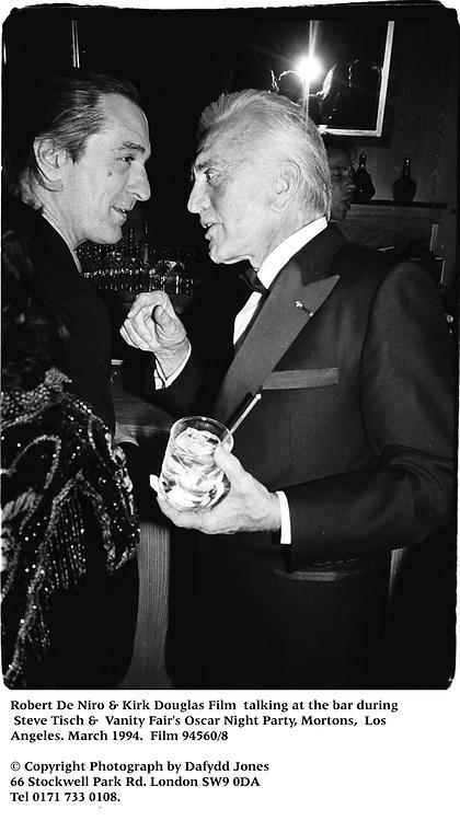 Robert De Niro & Kirk Douglas Film talking at the bar during  Steve Tisch &  Vanity Fair's Oscar Night Party,<br /> Mortons,  Los Angeles. March 1994.  Film 94560/8<br />  <br /> © Copyright Photograph by Dafydd Jones<br /> 66 Stockwell Park Rd. London SW9 0DA<br /> Tel 0171 733 0108.