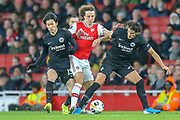 Arsenal defender David Luiz (23) battling past Eintracht Frankfurt midfielder Daichi Kamada (15) and Eintracht Frankfurt forward Gonçalo Paciência (39) during the Europa League match between Arsenal and Eintracht Frankfurt at the Emirates Stadium, London, England on 28 November 2019.